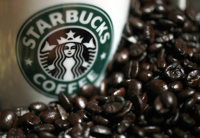 Starbucks cup with fresh coffee beans