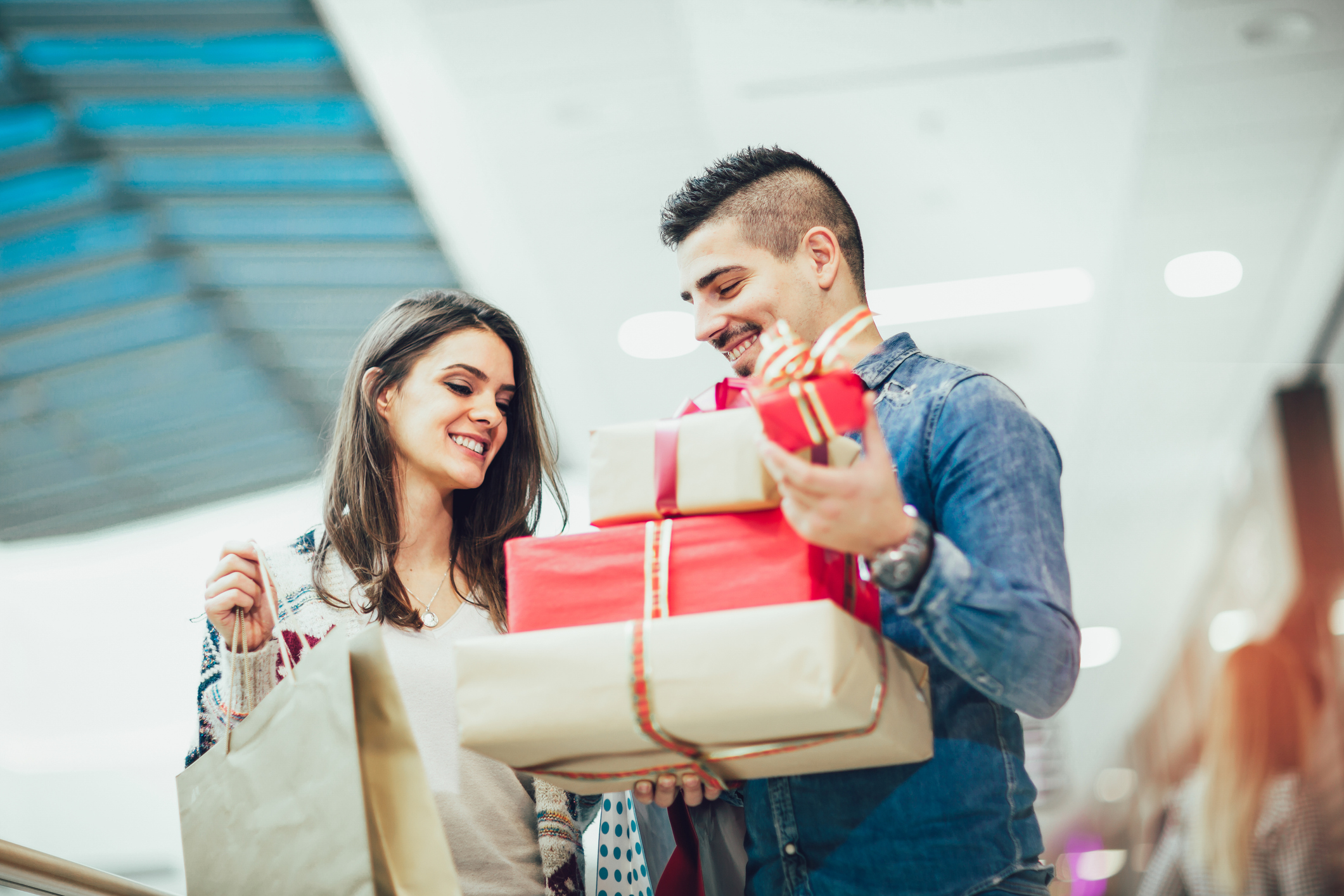 Young smiling couple doing last minute Christmas Shopping in Denton at Golden Triangle Mall